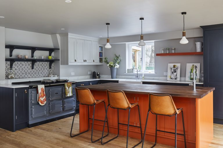 shaker style kitchen with orange island